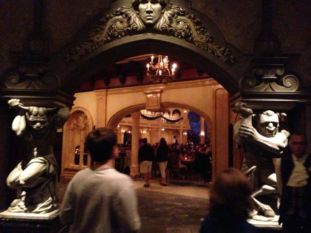 photo of Be Our Guest Restaurant entrance at night