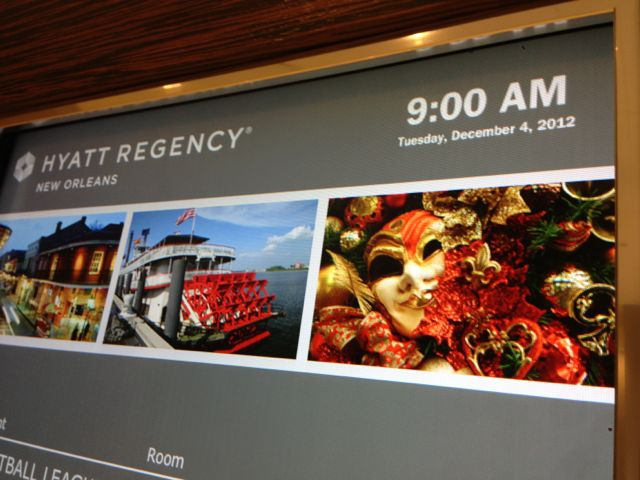 Hyatt Regency events board displays the time and date at the top