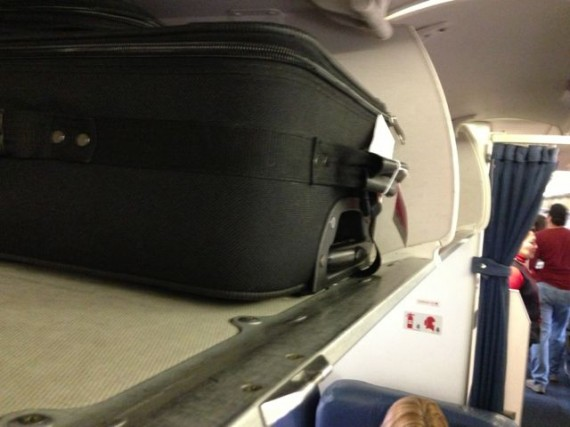 roller bag in Delta 1st class seating