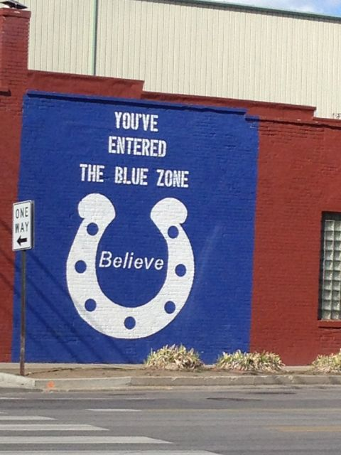 "Indianapolis building with large mural ""Believe"""