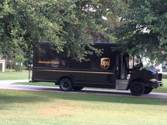 UPS delivery truck in rural neighborhood