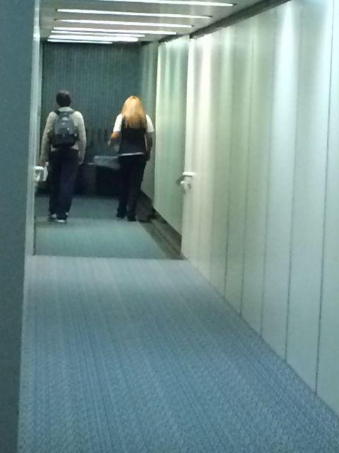Unaccompanied minor on Delta jetway with Delta agent