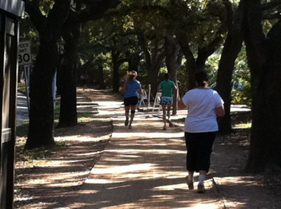 Runners and walkers on Rice University campus trail