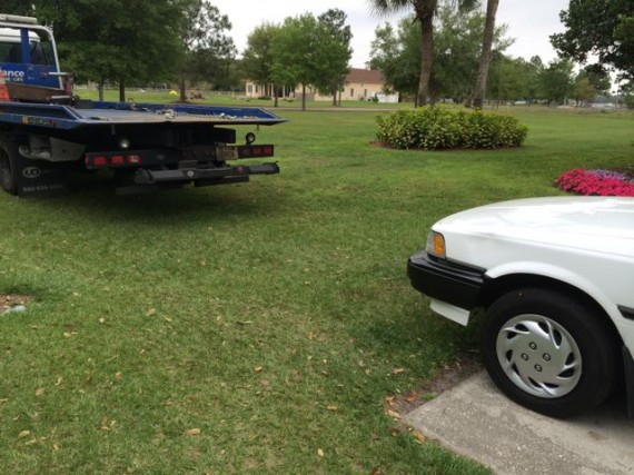 AAA tow truck about to tow 1990 Toyota Camry