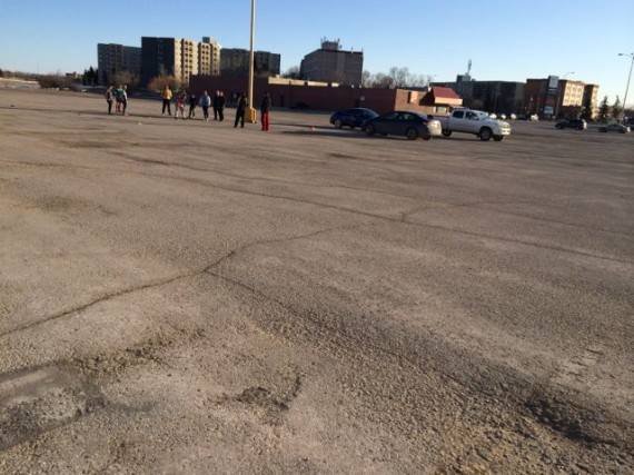 Middle aged adults conducting Rugby drills in Winnipeg parking lot