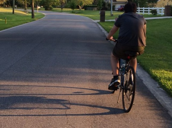Boy on bicycle in Central Florida neighborhood