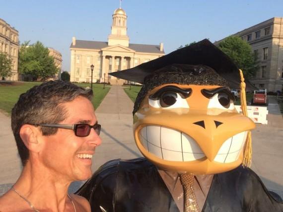 jeff noel with University of Iowa's Herky mascot