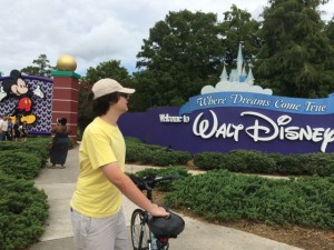 Local teenager riding bike to Disney World entrance
