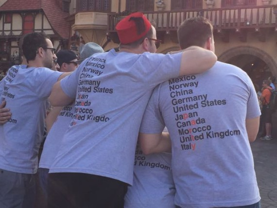 Group of young men drinking around the world at Epcot.
