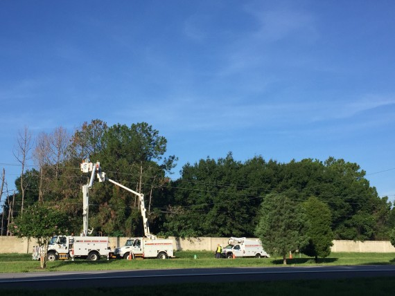 Duke Energy Trucks repairing restoring residential electric