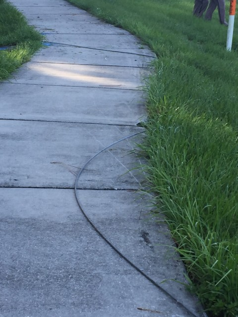Live electric wire on sidewalk