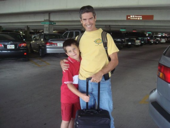 Father and son at airport