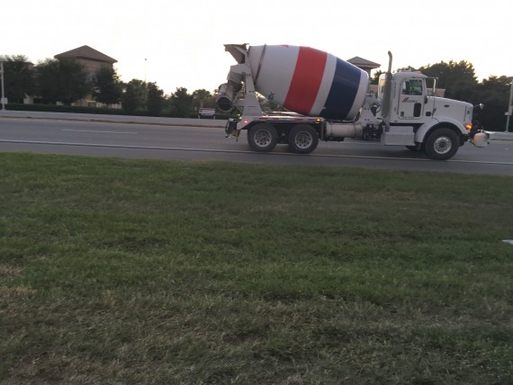 white, red, and blue cement truck