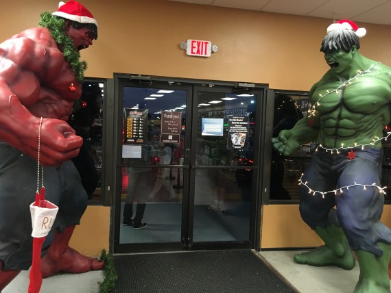 Two int Hulk statues at Coliseum of Comics