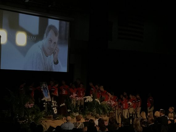 Memorial service for High School art teacher and football coach