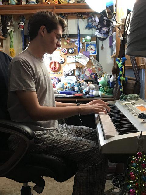 High Schooler practicing piano