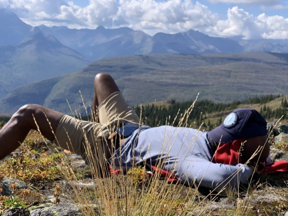 man napping in mountains