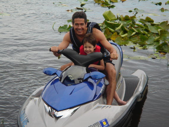 father and son on jet ski