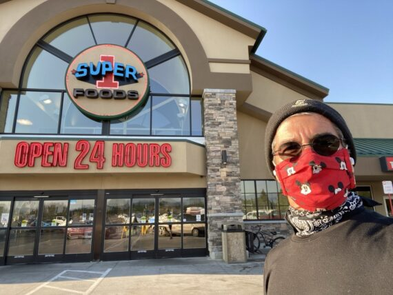 jeff noel, masked, in front of grocery store