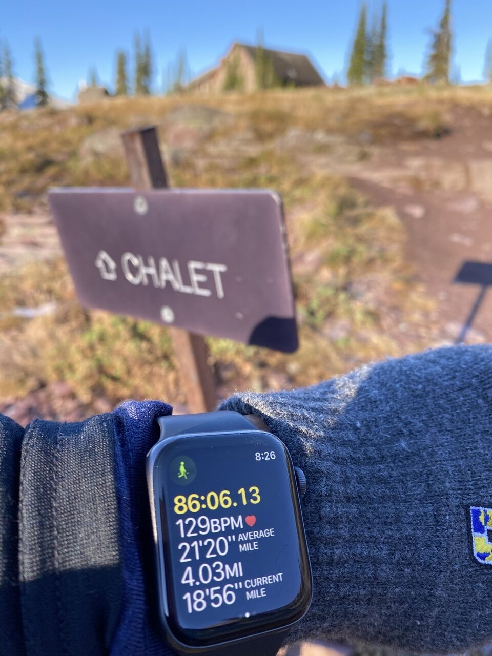Chalet sign and AppleWatch time/distance display