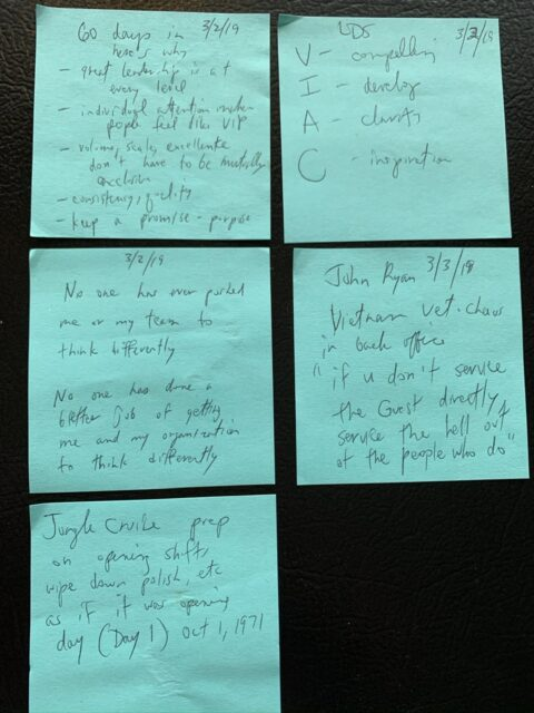 Five Post-it notes on a sheet of paper with handwritten notes