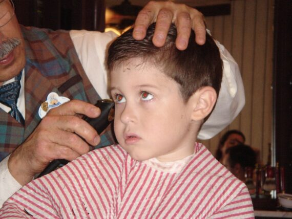 Child getting haircut at Magic Kingdom