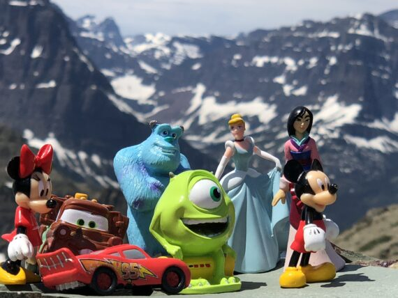 A handful of Disney character toys in the mountains