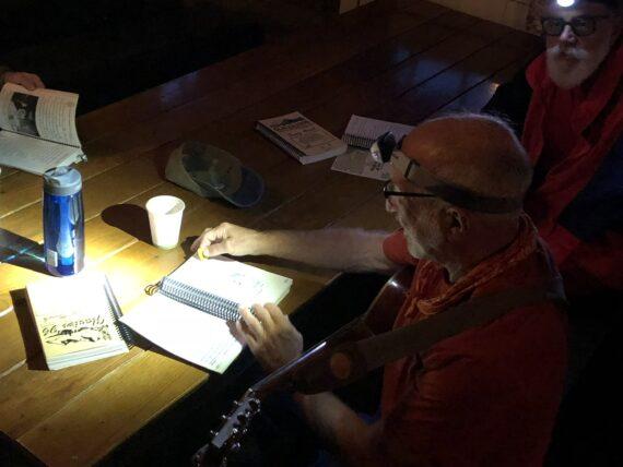 man using headlamp to read