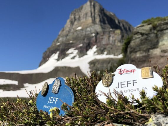 two disney name tags in the mountains