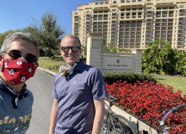 two men at Four Season Resort sign