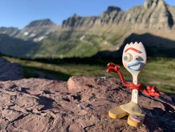 Disney toy character Forky in the mountains