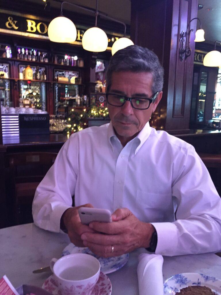 Disney employee culture author Jeff Noel writing on iPhone