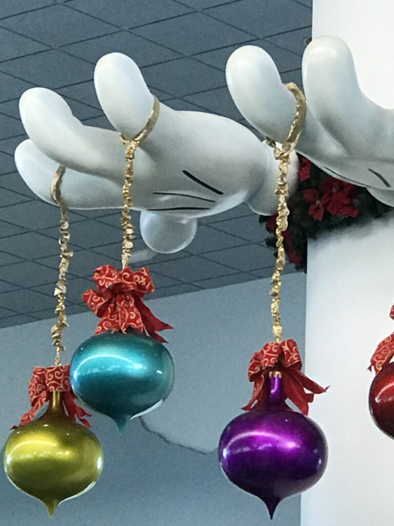 Large Christmas ornaments at Disney Cruise Line terminal lobby