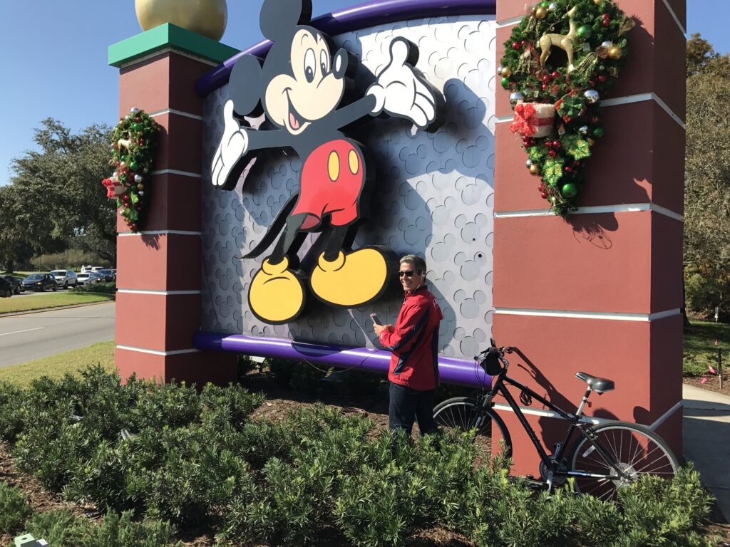 Disney employee culture author Jeff Noel writing at Disney Springs entrance