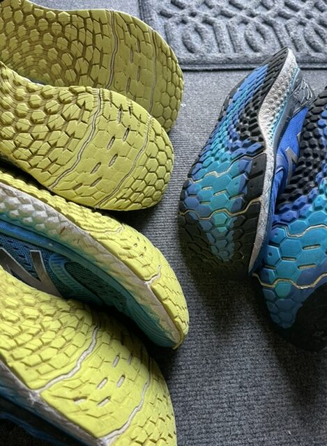 3 pairs of well worn running shoes