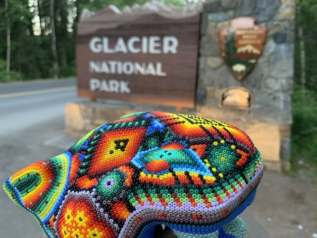 colorful bead design next to National Park sign